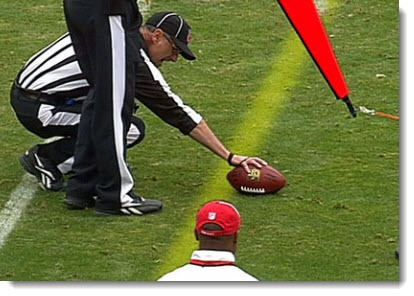 NFL - yellow line passing under objects & refs